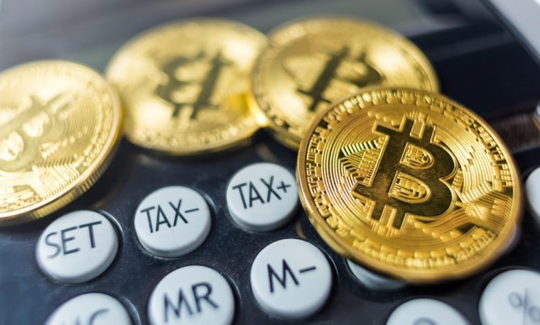Bitcoin coin with calculator as a tax payment concept